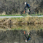 A youth rides his bike down the pathway next to Mavrakis pond Tuesday morning off West 8th Street. The pond is a popular spot for fishing and recreation. Justin Sheely/The Sheridan Press.