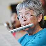 Bonnie Brady on Flute watches for her prompt from the director during the Concert in the Park performance by the Sheridan Concert Band Tuesday evening at Kendrick Park. The Sheridan Press|Ju ...