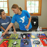 Twelve-year-old McKenna Arndt, left, and Soul Nelson, 13, look over the finished acrylic paintings during Kids' Art Camp Tuesday at Sagebrush Community Art Center inside the historic Train ...