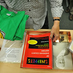 Judy Slack sorts through the contents of the time capsule during the Henry A. Coffeen School corner ceremony media conference Tuesday at the UW Agricultural Building at Sheridan College. Pie ...