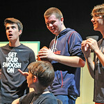 "Actors Garrett Szmyd, left, Elijah White, and Thomas Detmer, right, gather around lead actor Landon Alsup as Evan, below, during a rehearsal for the production of ""13"" Tuesday night at t ..."