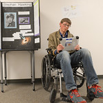 Tongue River middle-schooler Wyatt Yeigh plays a voice recording in the likeness of Stephen Hawking during the Hero Fair Tuesday at Tongue River Middle School. Each student picked and resear ...