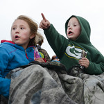 Eight-year-old Tamara Soltis, left, and Dain Soltis watch race cars move on the track Friday night at Sheridan Speedway. The race track reopened for the first time in ten years after a chang ...