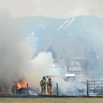 Sheridan Fire Rescue firemen douse a camper on fire Saturday at 86 North Park Road near the Sheridan County Airport. At noon Goose Valley Fire Department received the call from dispatch that ...