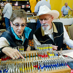Paula Griggs, left, and Bill Griggs of Chadron, Neb., try out various leather stamps from Chuck Smith Tools, a California-based company, during the Rocky Mountain Leather Trade Show Friday a ...