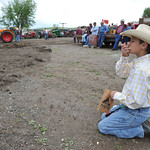 Brayton Ankney, 9, eats popcorn as he watches the Antique Tractor Pull Saturday at C&K Equipment on Commercial Avenue.