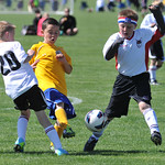 Sheridan County Storm player Daniel Magera, 8, kicks the ball past Casper defenders Saturday morning in the Boys U10 B Bracket game for the Snickers Cup at the Big Horn Equestrian Center.