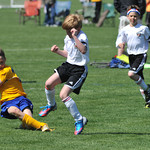 Storms player Shannon Holzerland, 10, slides after a pass in the B Bracket game against Casper for the Snickers Cup Saturday at the Big Horn Equestrian Center.