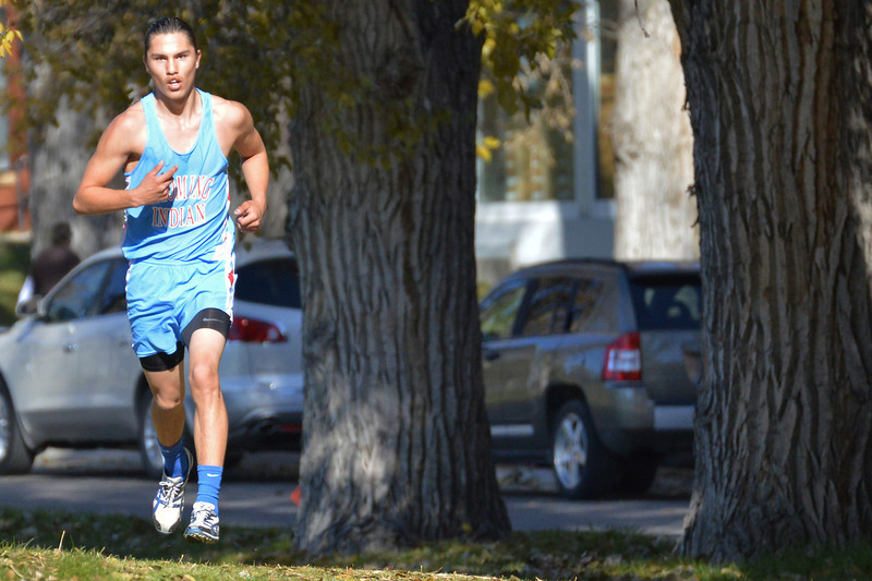 Wyoming Indian senior Wilson Clifford streches out his lead during the 2013 Wyoming State Cross Country Meet Saturday at the VA Medical Center in Sheridan. He won the 2A boys race with a time of 17:12.12(The Sheridan Press/Brad Estes)