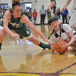 Eryn Aksamit dives for a loose ball against Burns.  Mike Dunn | The Sheridan Press