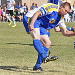 Defender Collin Eisenman clears a ball May 3 during the first half of Sheridan