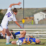 Maddy McClure hits the ground after colliding with a Gillette defender May 3 in Gillette.