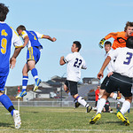 Players fly through the air during a free kick May 3 in Gillette. The Camels beat the Broncs 2-1.