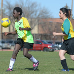 Sixth-grader Katie Vrieswyk, left, receives a kick as eighth-grader Kimberley Aguiler moves in during co-ed youth soccer Thursday at the YMCA fields. The YMCA offers soccer programs for yout ...