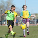 Sixth-grader Chance Ulin, left, makes a goal as Kassandra Stewart looks on during co-ed youth soccer Thursday at the YMCA fields. The YMCA offers soccer programs for youth from grades 1 - 8  ...