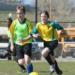 Eighth-graders Nolan Billings, left, and Garrett Avery race towards a ball kicked wide during co-ed youth soccer Thursday at the YMCA fields. The YMCA offers soccer programs for youth from g ...