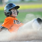 Trace Dobson slides safely into third base during on Tuesday at the 6th Street Fields. Dobson and the Orioles won the Webb Wright Minor League Championship, beating the Marlins 7-0. The Sher ...