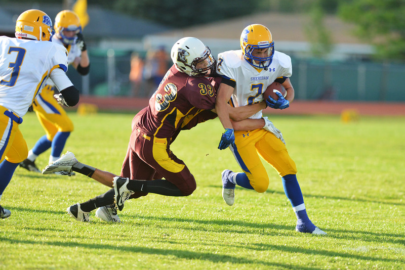Joe Shassetz fights for yardage in the first quarter Friday in Laramie.