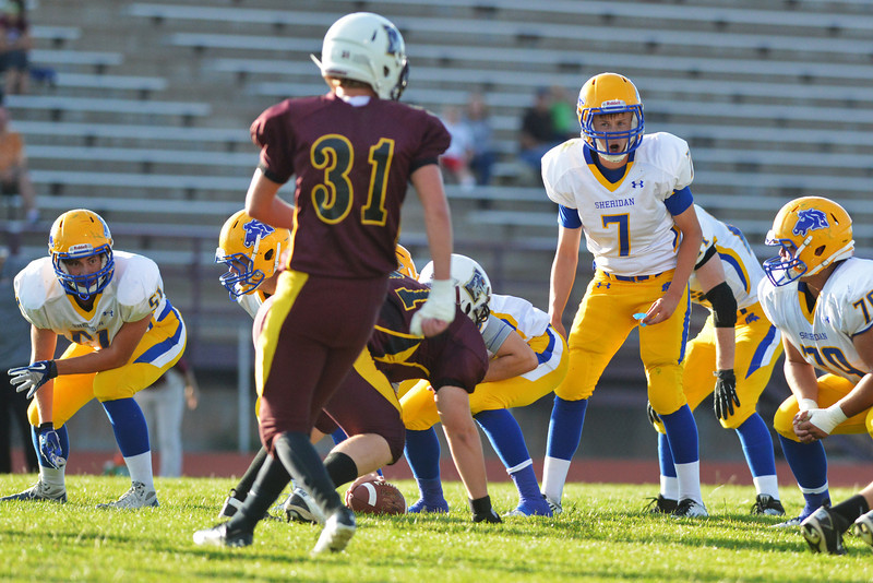 Bronc quarterback Kameron Eckard calls out his cadence in the first quarter at Deti Stadium in Laramie.
