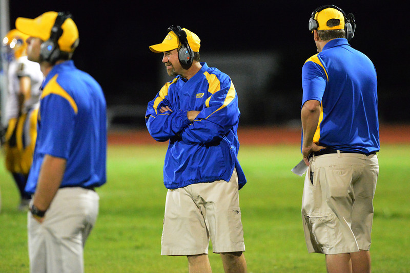 Sheridan head coach Don Julian walks down the sideline during the fourth quarter Friday in Laramie.