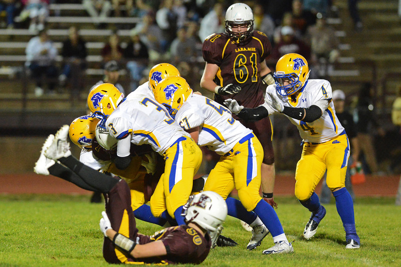 The Broncs gang tackle a Laramie runner in the backfield during the second half.