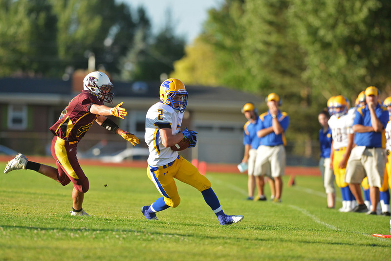 Bronc wideout Joe Shassetz gets outside of a Laramie defender Friday in Laramie. The junior had five catches for 37 yards and two scores.