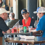Ashleigh Fox | The Sheridan PressZoila Perry, center, a 20 Under 40 recipient for the 2019 class, listens to conversation during the Happy Hour at Black Tooth Brewing Company while sporting  ...