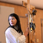 Justin Sheely | The Sheridan Press Eighth-grader Gloria Burns carries a crucifix for the altar service during Mass on Ash Wednesday at Holy Name Catholic Church. Ash Wednesday marks the begi ...