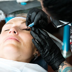 Matthew Gaston | The Sheridan PressPaige Pozos makes the final pass on Kyan Sanderson's left eye, ensuring that there are no inconsistencies on the eye lash enhancement Friday, Oct. 19, 20 ...