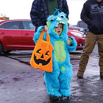 Matthew Gaston | The Sheridan PressKorbin Mayor, 4, trick-or-treats in fuzzy monster costume during Fremont Motors trunk-or-treat event Thursday, Oct. 31, 2019.