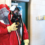 Matthew Gaston | The Sheridan PressFireman Jerry Johnston fixes a towel underneath the strap of his oxygen mask so he can wipe off steam and condinsation from the inside of his hazmat suit m ...