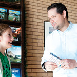 Matthew Gaston | The Sheridan PressHenry A. Coffeen 5th-grader, Brynn Kirol presents Executive Director of Travel and Tourism Shawn Parker with the Sheridan tourism pamphlet she made for a c ...