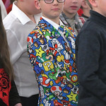 Matthew Gaston | The Sheridan PressDressed to impress in his Super Mario Bros. themed suit, Michael Colvin, lines up with his class mates for the big finale of the Holy Name Christmas Concer ...