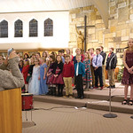 "Matthew Gaston | The Sheridan PressTennyson Lewallen, far right, and Freya Ter Haar perform as soloists during ""God is with Us"" ably backed by the 4th-grade class during the Holy Name Ch ..."