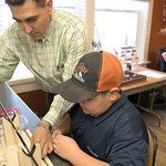 Matthew Gaston   The Sheridan PressJoey Puettman, left, assists 12-year-old Anthony Kindle with setting up to thread an eyelet on to the rod Kindle is building at Joey's Fly Fishing Founda ...