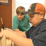 Matthew Gaston   The Sheridan PressRyder Dilloway, left, and his cousin Anthony Kindle do everything together from building fly rods, to fishing, to just horsing around at Joey's Fly Fishi ...
