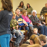 Matthew Gaston | The Sheridan PressFive-year-old Atticus Bublich rests his head on his mother, Samantha Bublich's boot during Meadowlark Elementary School's fifth-grade recital at Elmcro ...