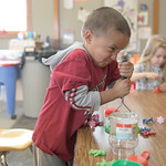 "Matthew Gaston | The Sheridan PressKaleb Beckman, 3, smooshes some slime at the science table during ""work time"" at Head Start Tuesday, April 9, 2019."