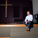 Matthew Gaston | The Sheridan PressPastor Tony Forman sits on the edge of the stage at Cornerstone Community Church looking forward to the next time he will be able to give a sermon to his c ...