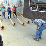 Matthew Gaston | The Sheridan Press A passer-by drops a tip in the bucket after listening to a selection performed by the Big Horn Alphorns on Main Street in Sheridan Saturday, April 20, 201 ...