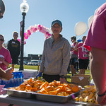 Ashleigh Fox | The Sheridan PressSarah Sommers volunteers at the snack table after runners finish The Link — Partners in Pink run Saturday, Oct. 20, 2018.