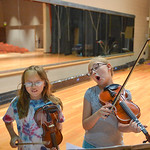 Justin Sheely | The Sheridan Press Eleven-year-old Victoria Smith, left, and Bri Doke, 9, practice together during the Summer Strings program Thursday at Sheridan High School. The program is ...
