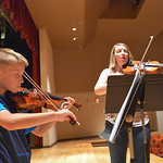 Justin Sheely | The Sheridan Press Nine-year-old Cameron Steidley practices on his violin with elementary orchestra teacher Erin Cummings during the Summer Strings program Thursday at Sherid ...