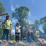 Justin Sheely | The Sheridan Press Girls scouts heat their hot dogs over the campfire during the Girl Scouts' Camp Rowena Wednesday at the Poulson Griffith youth camp on Big Goose Road. Th ...