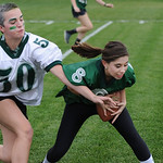 Justin Sheely | The Sheridan Press Freshman Kalli Aksamit, left, reaches out as Sierra McCoy, a senior, receives a pass during powderpuff football Thursday at Tongue River High School. TRHS  ...