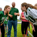 Justin Sheely | The Sheridan Press Senior Caylyn Dygon, left, and freshman Madi Miller face off as coach Steve Hansen officiates a coin toss for powderpuff football Thursday at Tongue River  ...