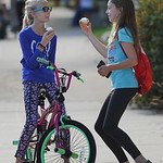 Justin Sheely | The Sheridan Press Twelve-year-olds Ridley David, left, and Chloe Wilson visit prior to the Tongue River High School Homecoming Parade on Friday in Dayton.