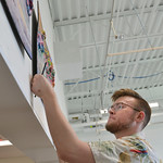 Justin Sheely | The Sheridan Press Sheridan College art student David Danielson puts up his acrylic art for the student art gallery Wednesday at the Whitney Center for the Arts. The student  ...