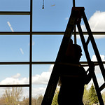 Justin Sheely | The Sheridan Press A Sheridan College art student moves a ladder across the room during installation for the student art gallery Wednesday at the Whitney Center for the Arts. ...