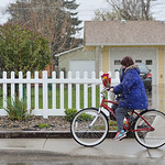 Justin Sheely | The Sheridan Press A woman rides a bicycle on Sheridan Avenue Tuesday in Sheridan. The rest of the week is supposed to be grey with chances of rain mixed with snow and temper ...